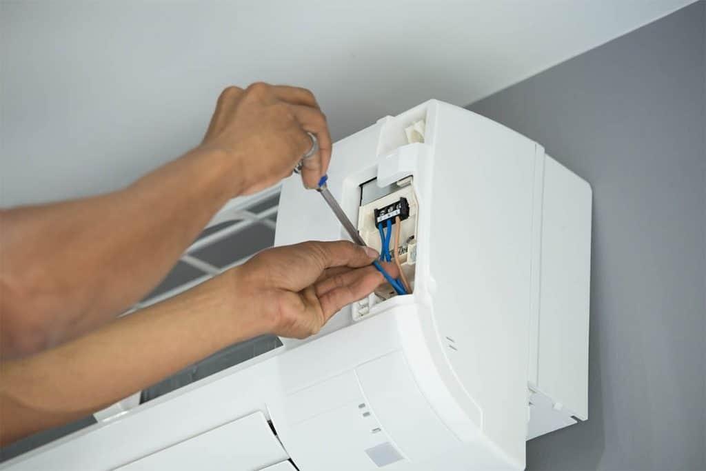 AC unit repair guy fixing it